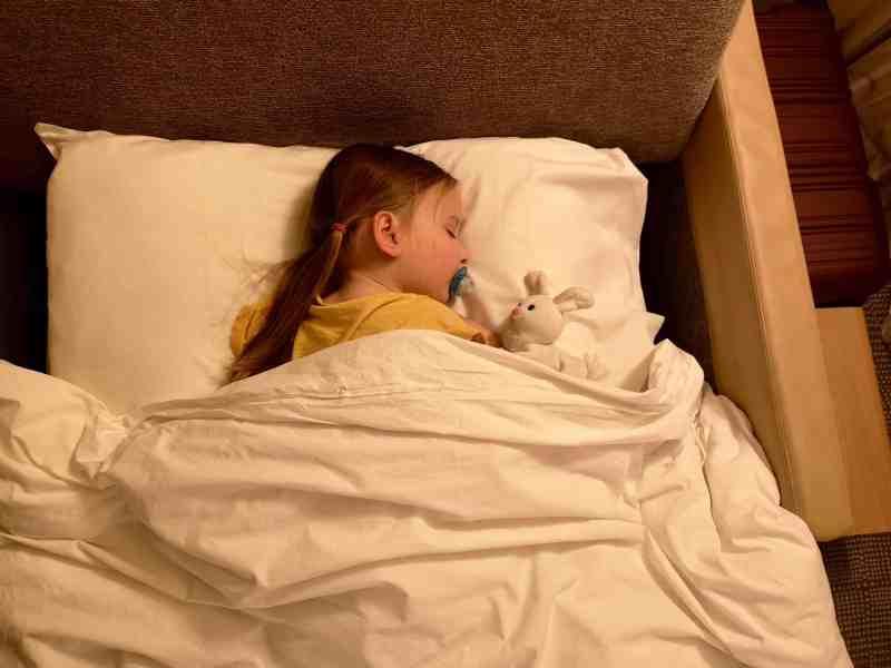 Erin asleep in a hotel bed