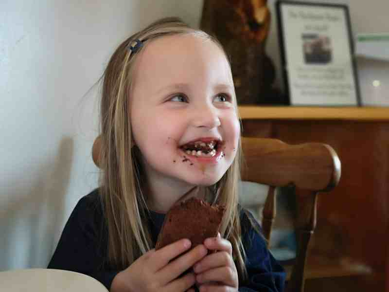 Erin eating a brownie
