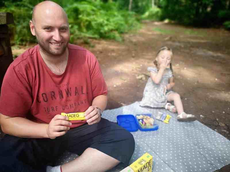 John and Erin eating MadeGood's granola bars