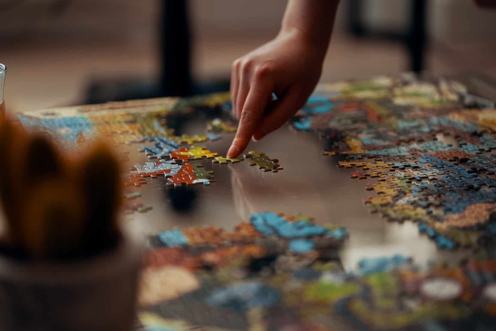 Person doing a jigsaw puzzle