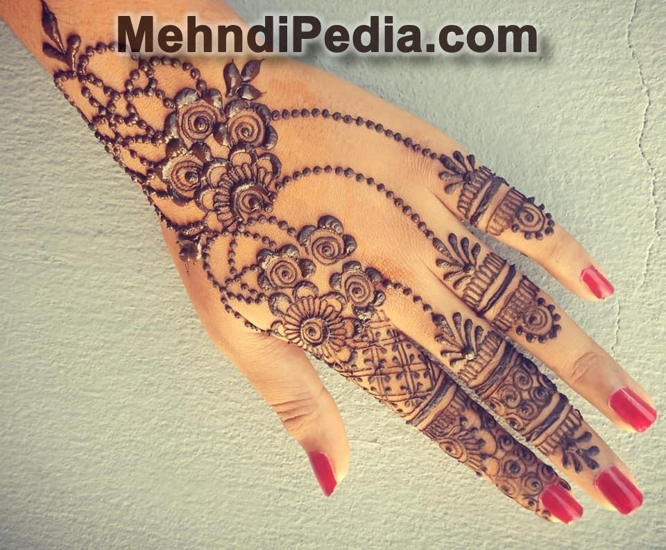 Latest Mehandi designs for left hand back side 2nd pose