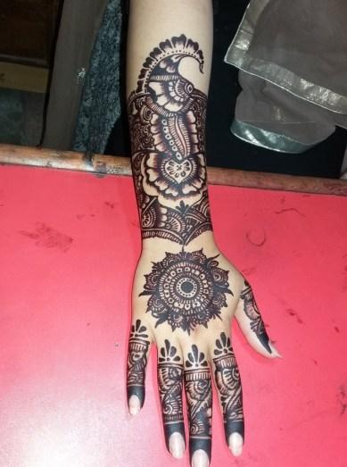 full backhand mehndi designs finger to wrist