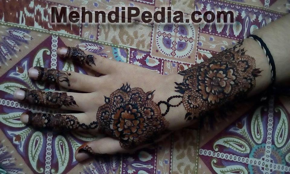 super back hand mehndi designs images
