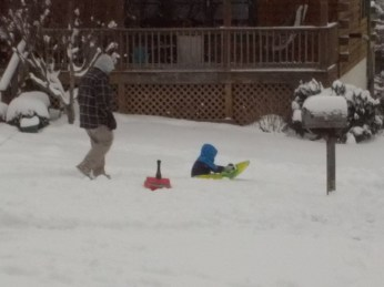 012316 Logan uses our plastic sled