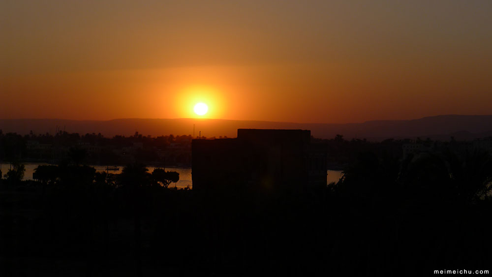 Intensely orange sunset from the top of Nefertiti Hotel in Luxor.
