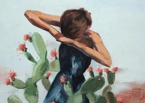 mujer rodeada de cactus luchando para demostrar valentía