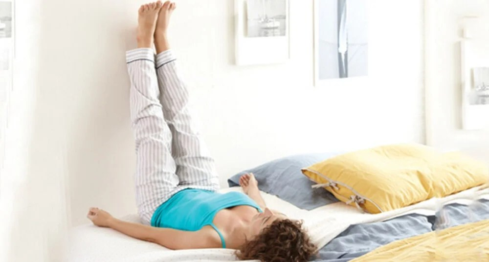 elevar-piernas-cama