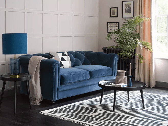 A deep blue  Patrick  - with a classic chesterfield design