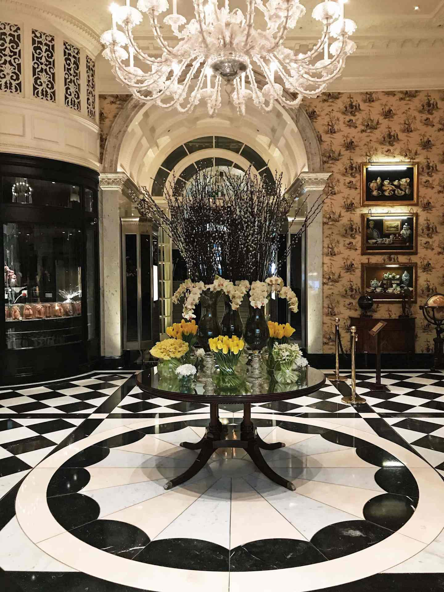 Stuninng chandelier and floral display in the Upper Thames Foyer