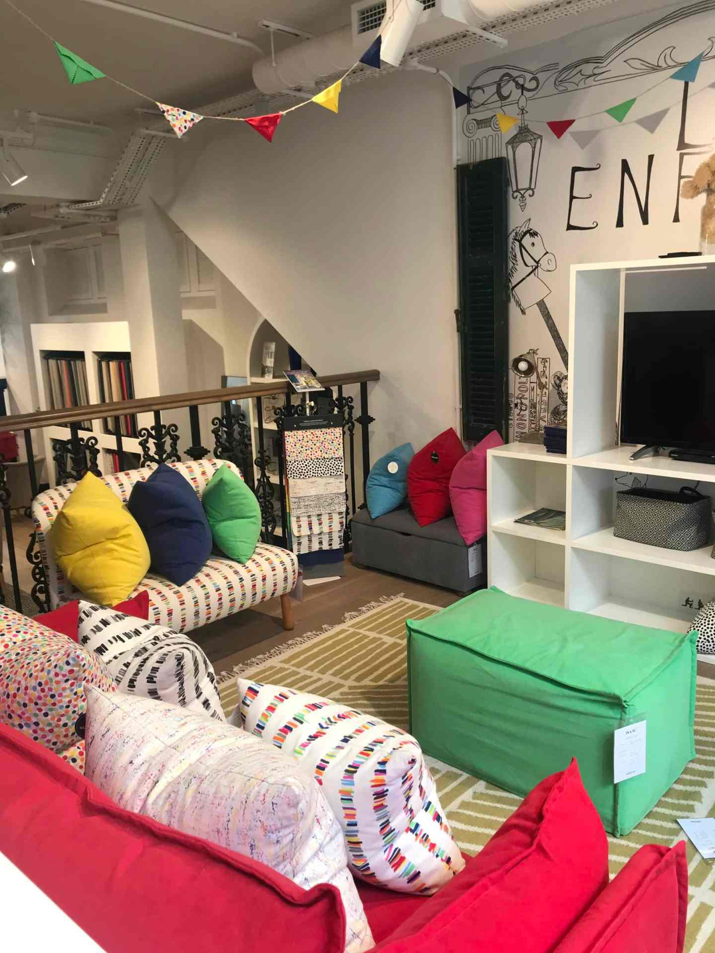 Such a cute little corner and the kids get to watch movies! Sounds like the perfect day out. The  Alfie Sofa in Tutti Frutti Caterpillar  and  Isaac footstool in Chocolate Lime