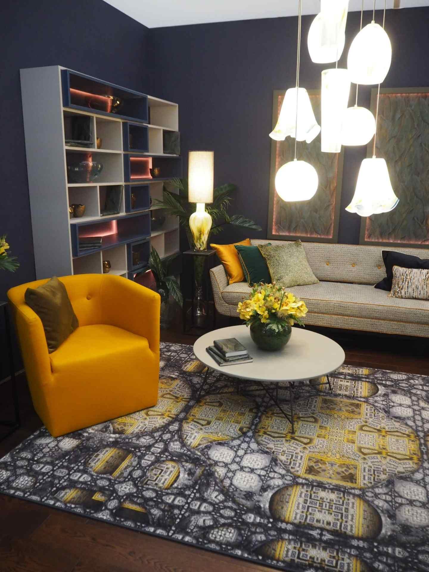 Mustard tones, with beautiful orange piping on the sofa