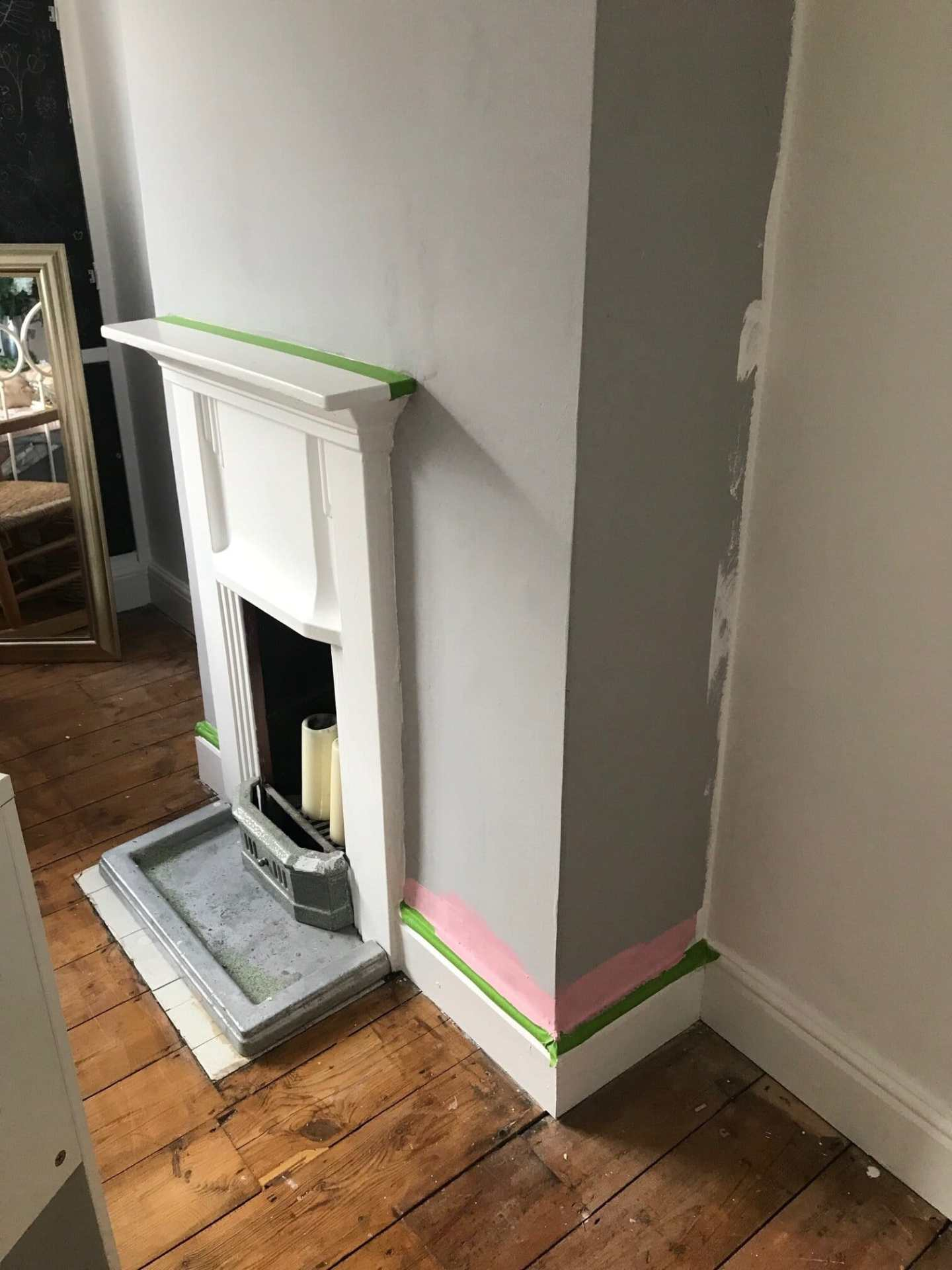 Frog tape around the edges to stop the paint dripping onto the white fireplace and skirting boards