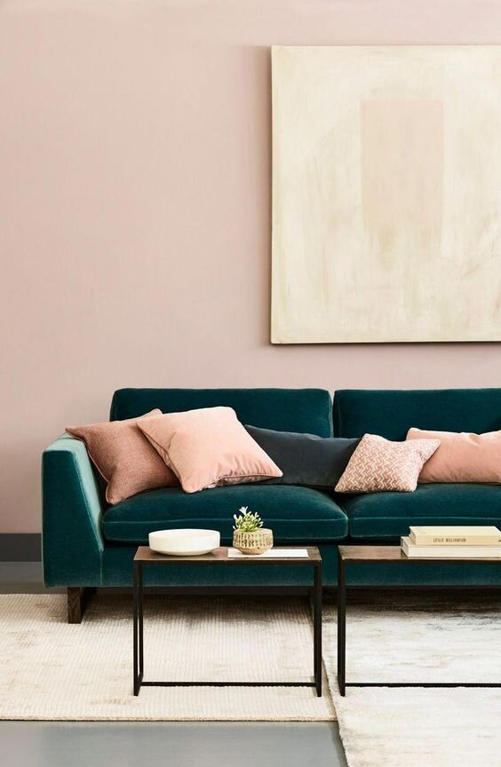 Very soft pinks are used to break up the green of this beautiful sofa but not take centre stage! Credit: www.love-your-home.co.uk