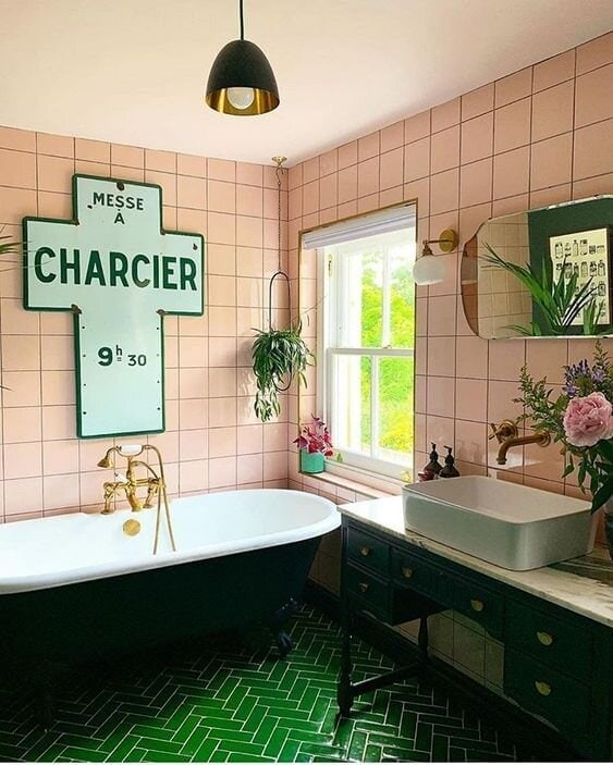 Green metro tiles provides a dramatic flooring backdrop and the colour is softened by adding pink square tiles. Credit: @maxmademedoit