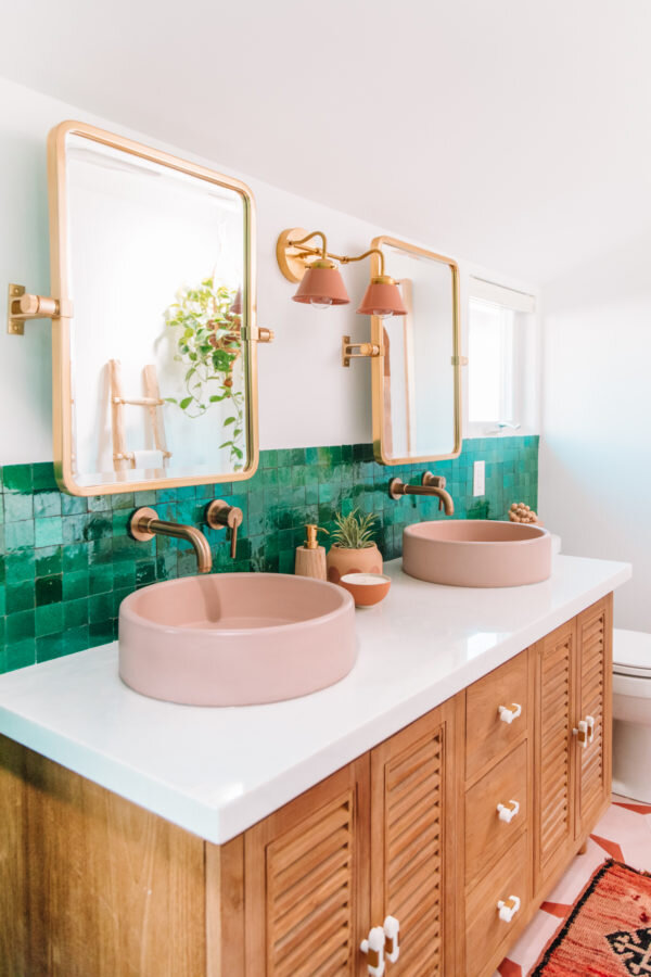 In this fabulous bathroom renovation, they have used square green tiles and my favourite addition, pink sinks! Credit: studiodiy.com