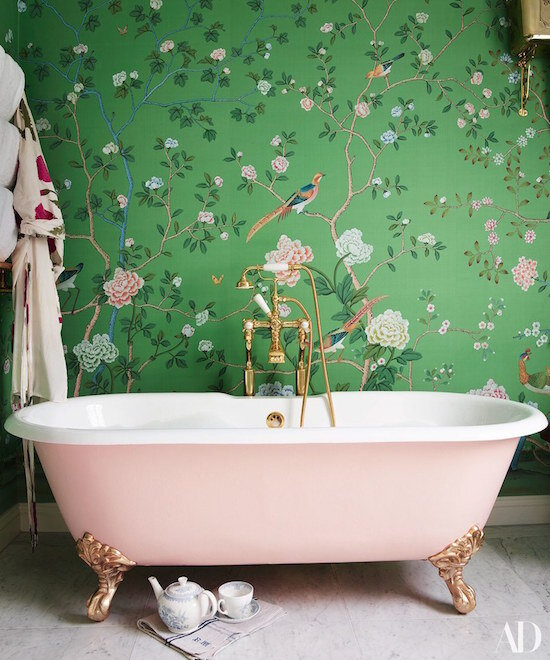 Poppy Delevgines beautiful green floral wallpaper and pink bath tub bathroom Credit: Architectural Digest
