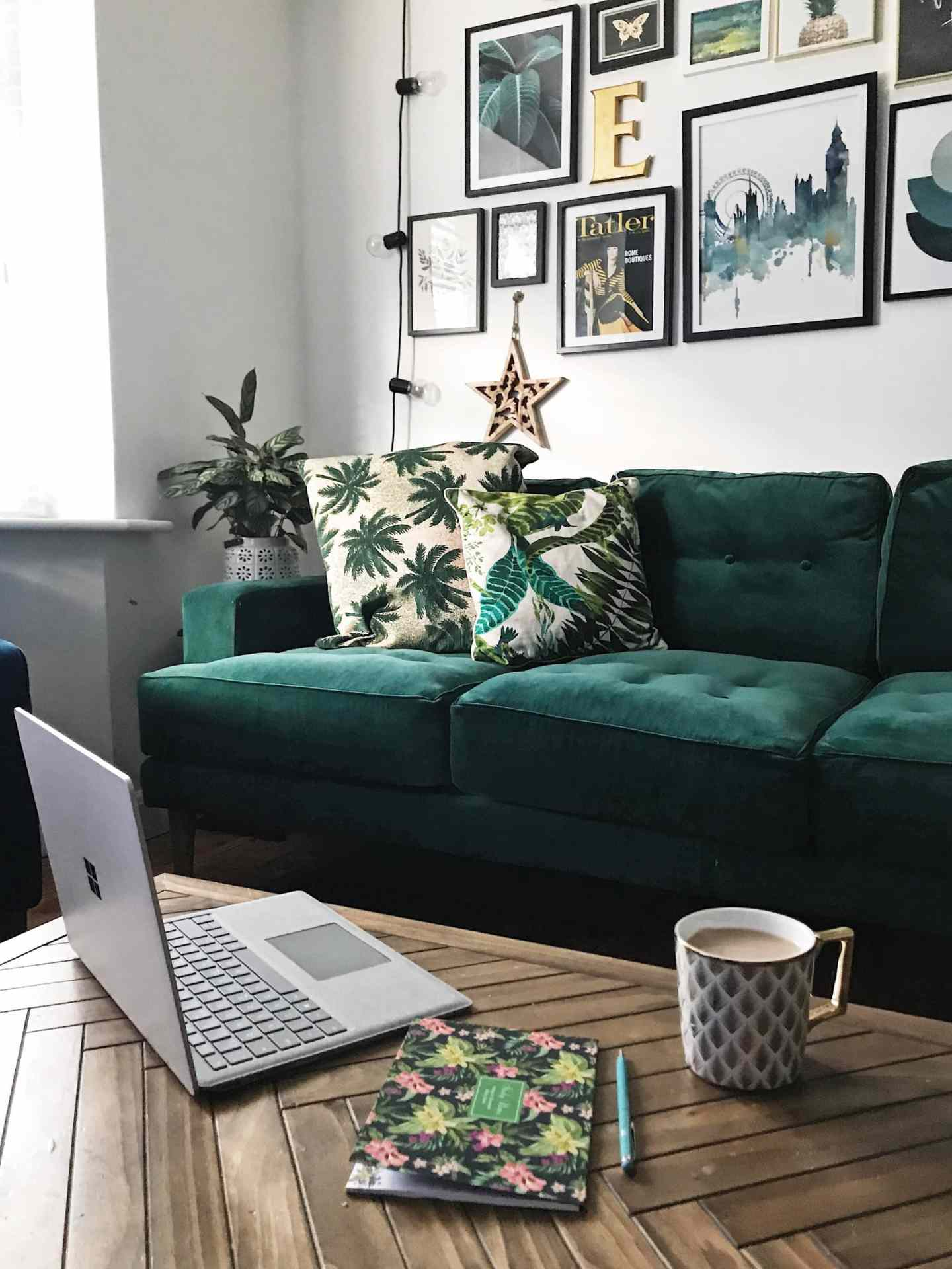 a bloggers work place. the sofa, coffee table and laptop