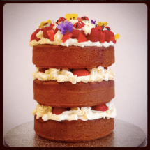 vanilla layer cake with fruit and flowers