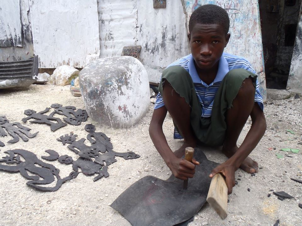 One of the kids making art at the Grand Rue. Photo thanks to Haiti: The Bradt Travel Guide