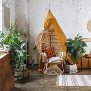 Rattan wicker chair and plants bohemian decor