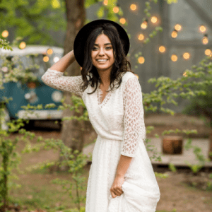White dress and hat with outdoor fairy lights boho style