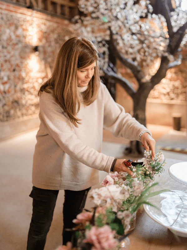 woolly knit jumper with jeans flowers and blossom tree in flint barn