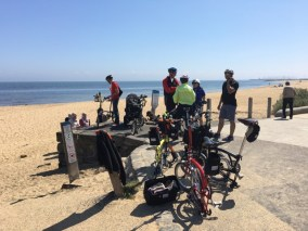 Cory giving the Brompton run down & demo to some fascinated ladies on the beach