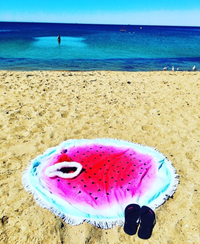 Watermelon towel at beach
