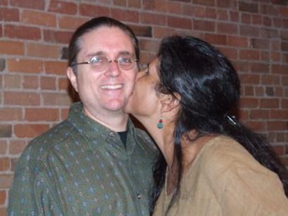Maria steals a kiss...