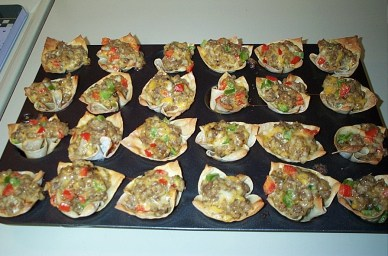 One of my fav guest snacks: sausage, cheese, peppers baked in wonton wrappers.