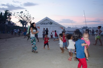 Dancing with the tent city kids. The visited me at the Boarding House nearly every day.