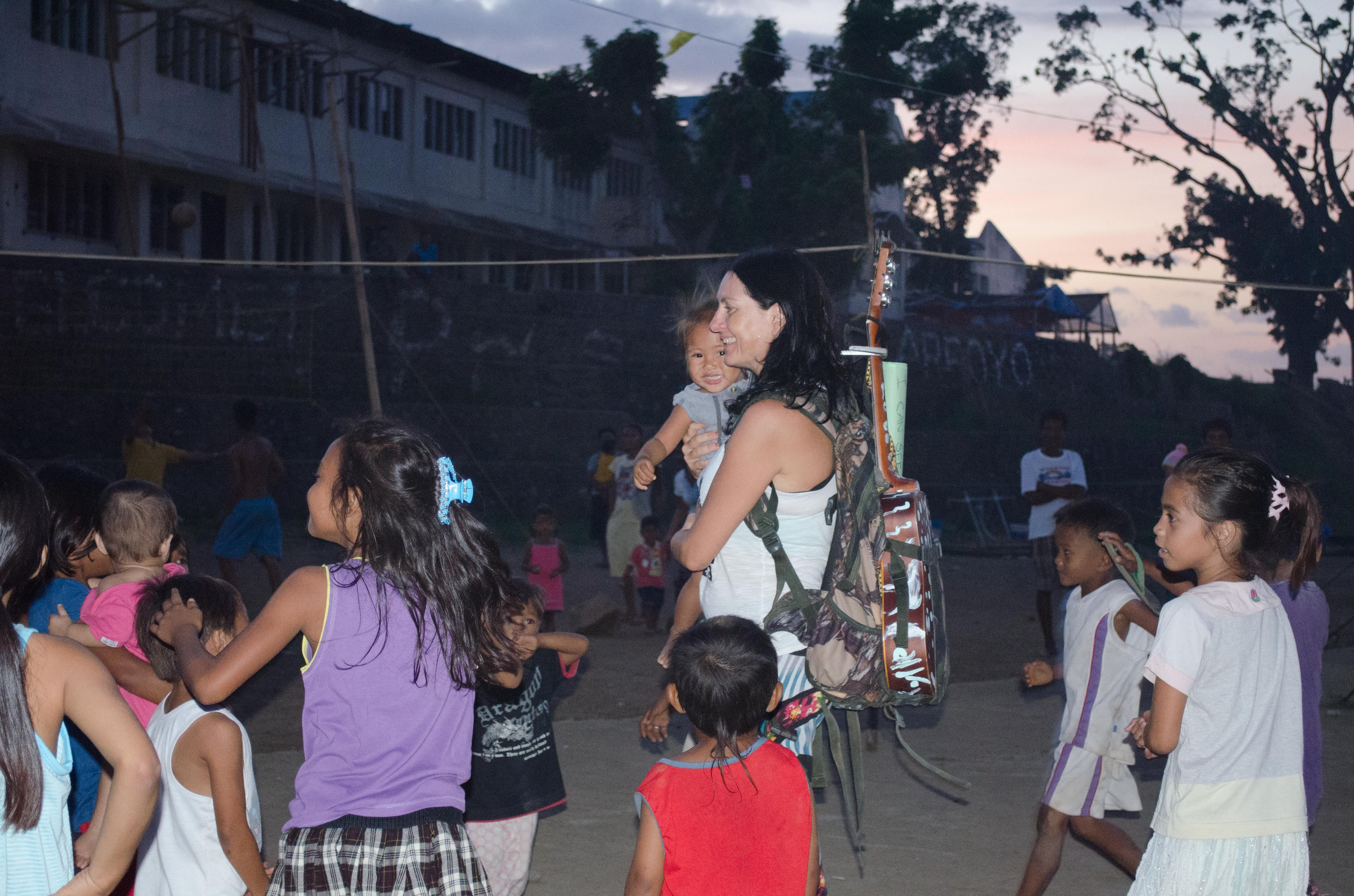 Dancing with the tent city kids Estancia (Philippines) following Typhoon Yolanda.