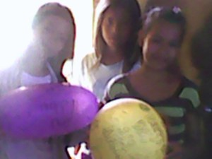 Note pic from my dodgy roadside phone of the girls making one of the balloon deliveries.
