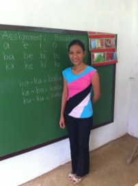 teacher in front of her new blackboard