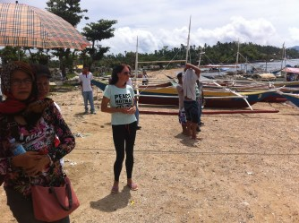 Walking down the beach as the boats are blessed by Father Nolan C. Machan.