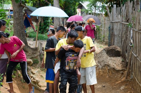 Sancho was carried down the hill by his relatives so we could transport him to hospital.