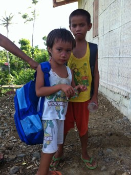 Two boys enjoying their new backpacks.