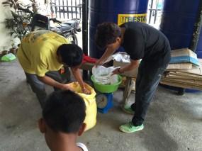 Weighing rice packs.