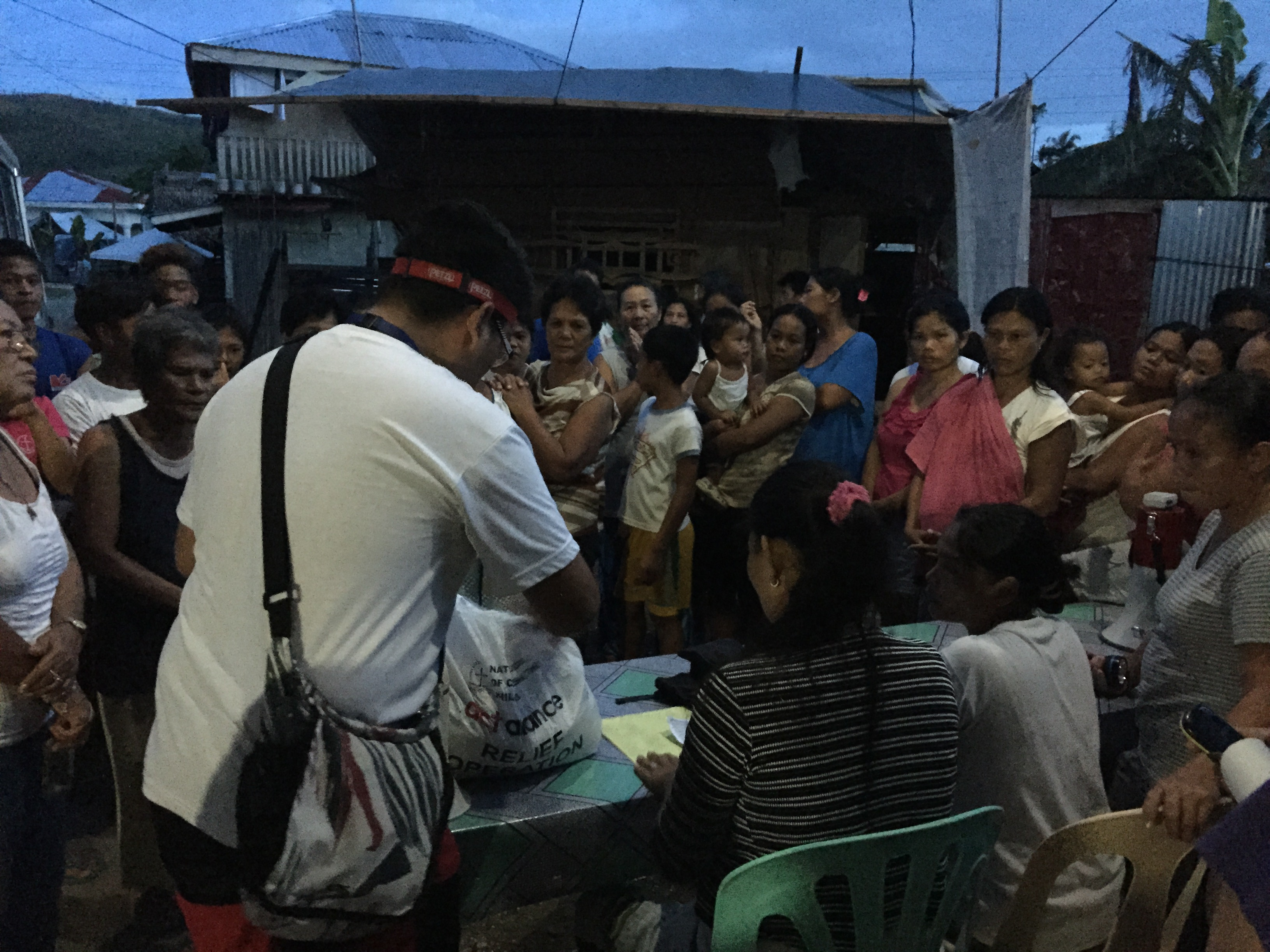 ACT Alliance hands out typhoon relief goods