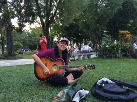 Playing guitar at Plaza Molo