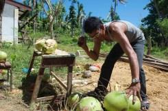 liboy cuts coconuts at Tanza