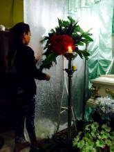 maecy arranges fresh flowers for her father