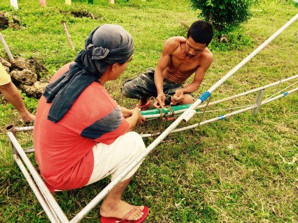 men of botongon repair the tent