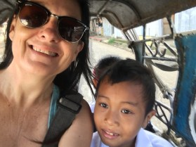 riding the tricycle to school3