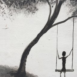 black and white mural of a figure on a swing under a tree