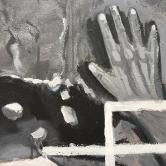 black and white mural of hand pressed against a wall
