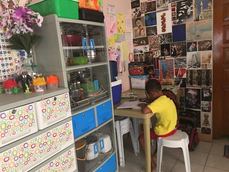 little boy doing his homework