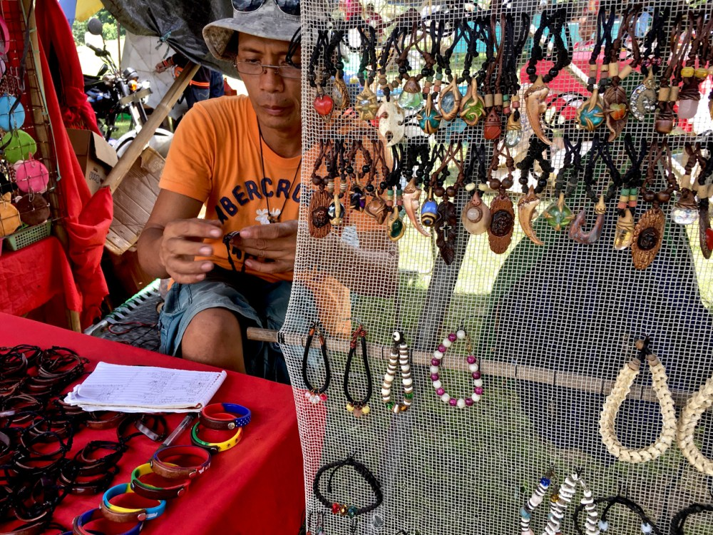 leather and jewellery craftsman at a local market