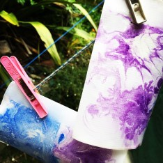 paper marbling hanging to dry