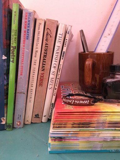 stack of poetry books on a desk